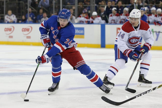 New York Rangers right wing Kaapo Kakko (24) plays the puck against Montreal Canadiens center Nick Suzuki (14) during the second period at Madison Square Garden.