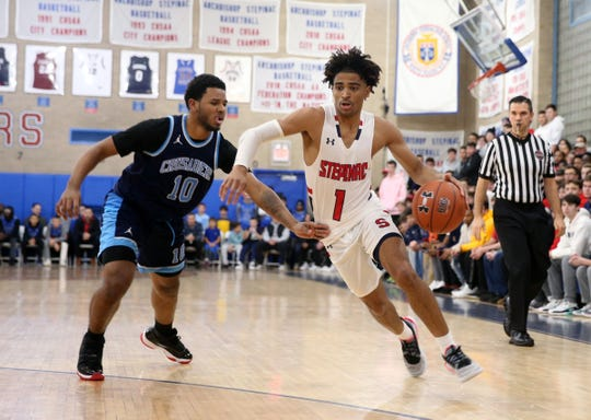 Stepinac's R.J. Davis (1) handles the ball in the first half of their 81-69 win over Monsignor Scanlan at Stepinac High School in White Plains on Friday, December 6, 2019.