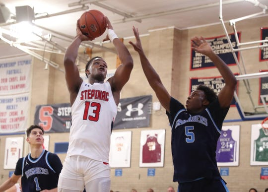Stepinac's Malcolm Chimezie (13) does up for a shot during their 81-69 win over Monsignor Scanlan at Stepinac High School in White Plains on Friday, December 6, 2019.