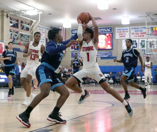 Stepinac's RJ Davis (1) drives to the basket and draws a foul during their 81-69 win over Monsignor Scanlan at Stepinac High School in White Plains on Friday, December 6, 2019.