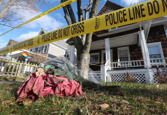 A bouquet of flowers placed on the ground outside the Liu family home in Pleasantville on Saturday, December 7, 2019.