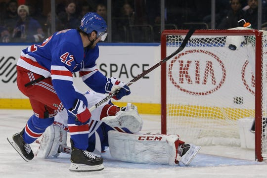 Dec 6, 2019; New York, NY, USA; New York Rangers defenseman Brendan Smith (42) scores against Montreal Canadiens goalie Carey Price (31) during the second period at Madison Square Garden. Mandatory Credit: Brad Penner-USA TODAY Sports