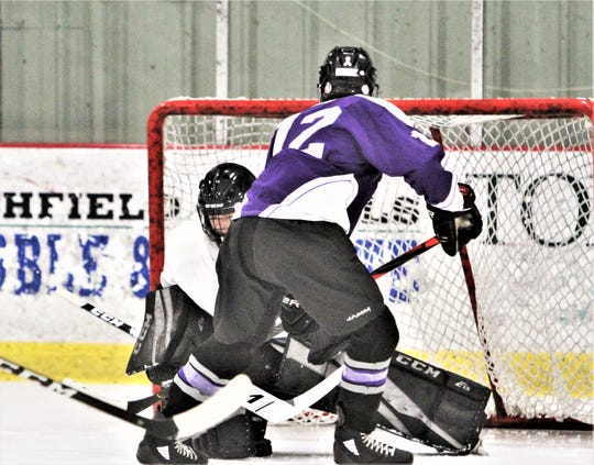 John Jay-CR's Tyler Wishart scores his fourth goal, beating BYSNS goalie Matthew Gergley after getting behind the defense during the Indians' 7-0 win Dec. 6, 2019.