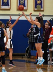 Ursuline's Alexa Quirolo (22) goes up for a shot in front of Lourdes Sofia Feigelson (22) during girls basketball action at Our Lady of Lourdes High School in Poughkeepsie Dec. 7, 2019. Ursuline won the game 51-38.