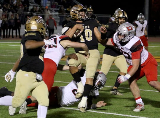 Rider's Jacob Rodriguez is tackled by Lubbock Cooper defenders Friday, Dec. 6, 2019, at Bulldog Stadium in Abilene.