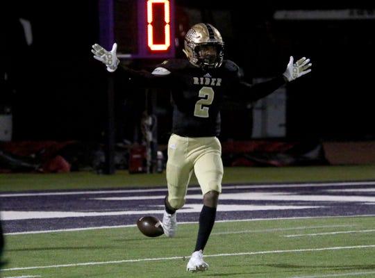 Rider's Nick Darcus celebrates his touchdown against Lubbock Cooper Friday, Dec. 6, 2019, at Bulldog Stadium in Abilene.