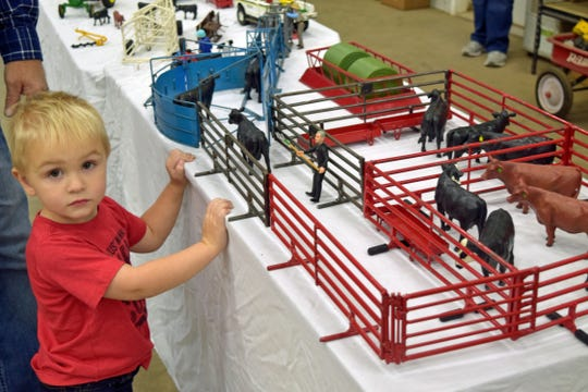 Charlie Anliker loves playing with the cattle corrals made by his grandfather, David Melland of Forbes, N.D.
