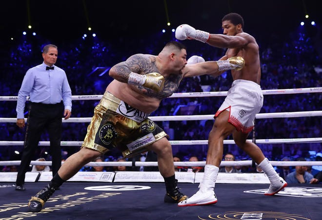 Anthony Joshua dodges a punch from Andy Ruiz Jr during their heavyweight title fight between in Diriyah, Saudi Arabia on Saturday.