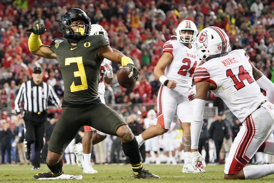 Oregon Ducks wide receiver Johnny Johnson III celebrates a first down against the Utah Utes.