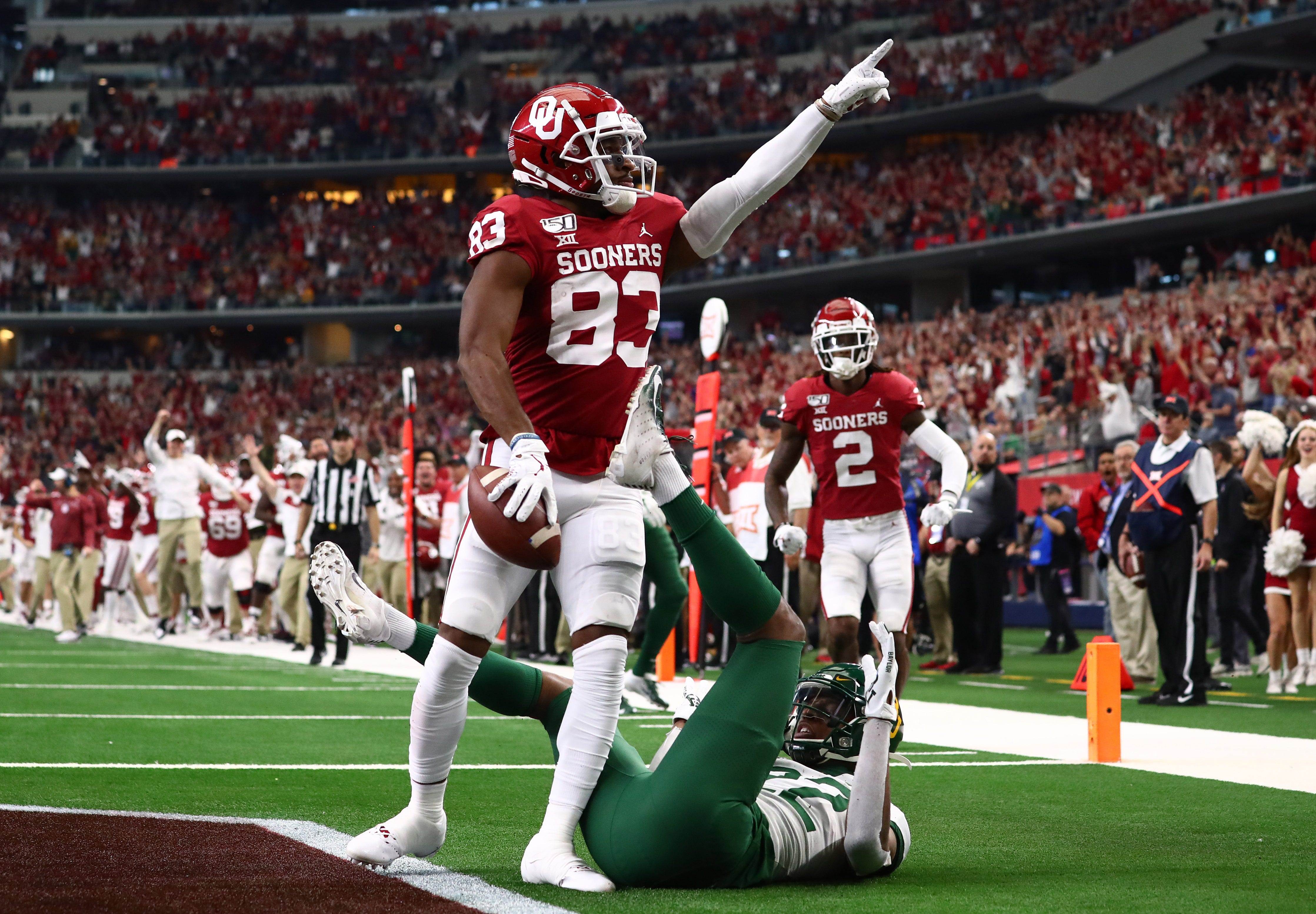 Oklahoma boosts playoff hopes after beating Baylor for its fifth Big 12 title in a row