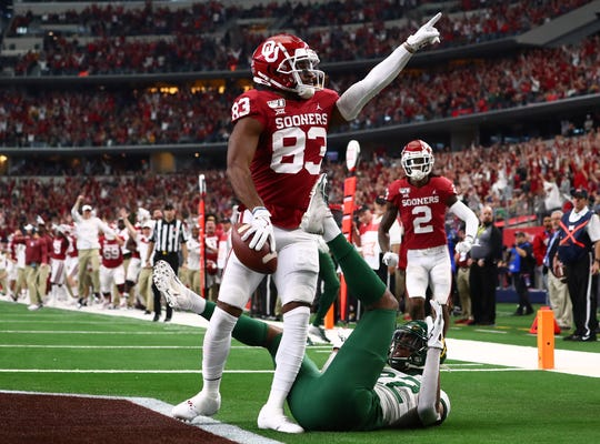 Oklahoma receiver Nick Basquine points to the stands after catching a  touchdown in the third quarter against Baylor in the 2019 Big 12 Championship Game at AT&T Stadium.