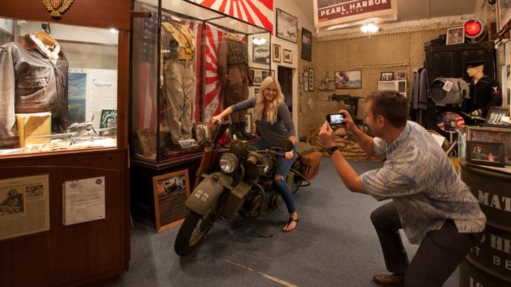 "Home fo the Brave is an ""experiential"" museum where guests are encouraged to climb aboard the vintage Harley Davidson motorcycle that appeared in the 1991 film ""Pearl Harbor."""