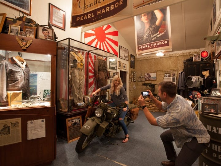 """Home fo the Brave is an """"experiential"""" museum where guests are encouraged to climb aboard the vintage Harley Davidson motorcycle that appeared in the 1991 film """"Pearl Harbor."""""""