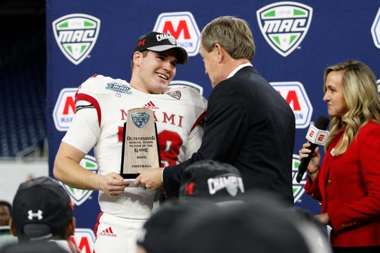 Miami (Ohio) place kicker Sam Sloman is given the special teams player of the game award after winning the MAC championship game against Central Michigan at Ford Field.