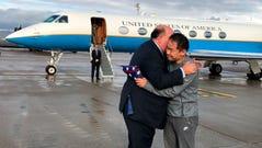 U.S. Ambassador to Switzerland Edward McMullen greets Xiyue Wang after landing in Zurich, Switzerland on Saturday, Dec. 7, 2019.