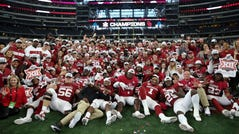 Oklahoma players and coaches take a team photo after beating Baylor in overtime of the 2019 Big 12 championship game at AT&T Stadium.