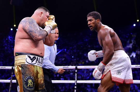 Anthony Joshua, right, taunts Andy Ruiz Jr. during their heavyweight title fight.
