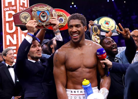 Anthony Joshua celebrates his victory over Andy Ruiz Jr. to reclaim the IBF, WBA, WBO & IBO World Heavyweight title.