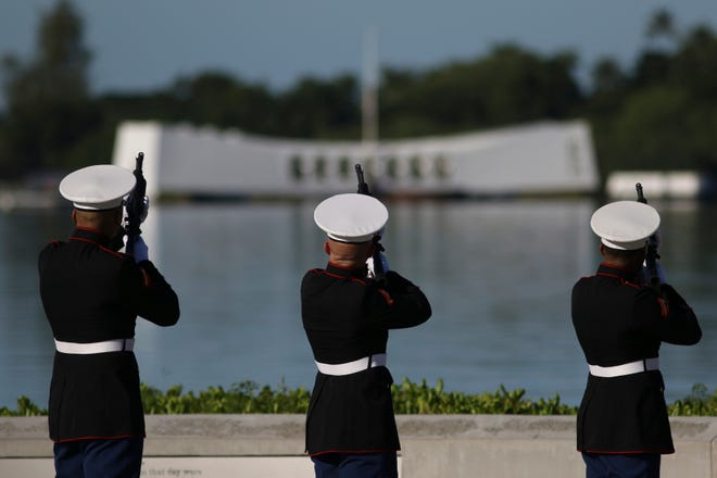 U.S. Marine perform in front of the USS Arizona Memorial during a ceremony to mark the 78th anniversary of the Japanese attack on Pearl Harbor, Saturday, Dec. 7, 2019 at Pearl Harbor, Hawaii.