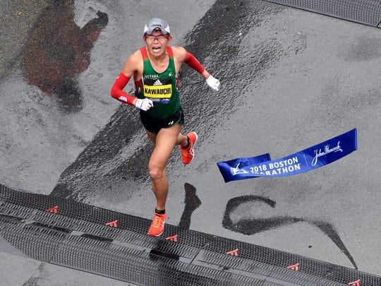 Yuki Kawauchi crosses the finish line of the 2018 Boston Marathon winning the men's division on April 16, 2018.