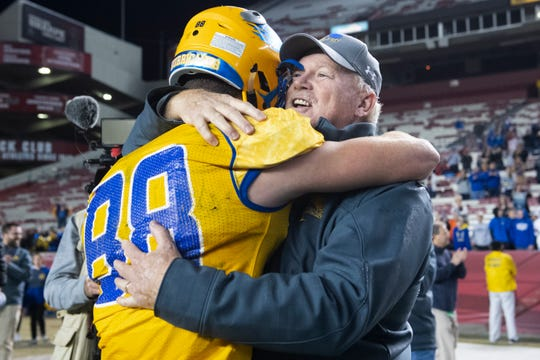 Wren Head Coach Jeff Tate hugs Wren's Eli Wilson (88) after winning the Class AAAA state championship against Myrtle Beach High School at Williams-Brice Stadium in Columbia Saturday, Dec. 7, 2019.