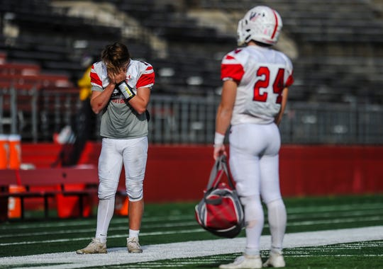 A dejected Logan Peters of Wall after  the Crimson Knights were defeated 12-7 by Woodrow Wilson 12-7 in the South Group III regional championship game at SHI Stadium in Pisacataway