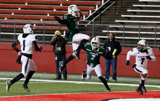 DePaul's Marshawn Ferguson, Jr. jumps into the endzone to score a TD against Mater Dei in the NJSIAA Group III Non-Public Championship at SHI Stadium in Piscataway Saturday, December 7, 2019.