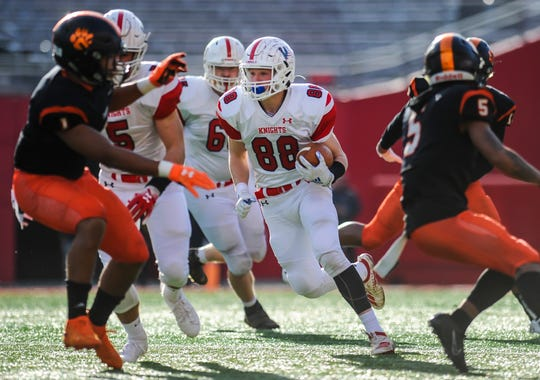 Matt Dollive of Wall runs for extra yards against Woodrow Wilson in the South Group III regional championship game at SHI Stadium in Piscataway.