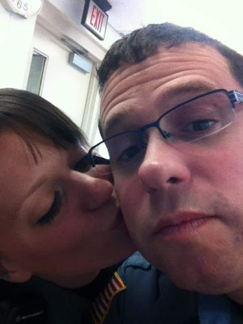 Susan Reeves kisses her husband, Chris Reeves. He was killed during a pursuit in 2012.