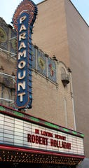 The Paramount Theatre marquee Sunday honored Robert Holladay, who became its class film director in 1973 and, it was stated at his memorial, will hold that job through 2020 because he already had picked out next year's movies.