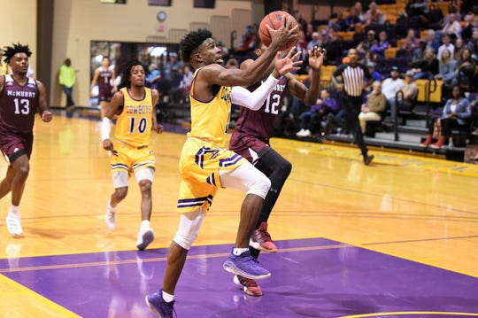 HSU's Chris Barrett (1) goes up for a layup during the ASC opener against McMurry at the Mabee Complex on Saturday. The 76-62 loss was the second-straight for the Cowboys.