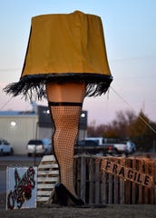 """An oversized replica of the leg lamp from """"A Christmas Story"""" stands outside the Hawley Independent School District building Saturday."""