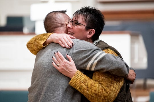 Charlie Fulbright and Deana Spencer embrace during Battle Creek Pride's Winter Extravaganza on Saturday, Dec. 7, 2019 at First Congregational Church in Battle Creek. Battle Creek Pride presented awards at the extravaganza that recognized allyship and hard work within the community.