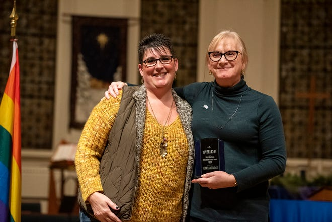 Battle Creek Pride co-presidents Deana Spencer and Kim Langridge during Battle Creek Pride's Winter Extravaganza on Saturday, Dec. 7, 2019 at First Congregational Church in Battle Creek, Mich. The nonprofit will be opening its office and resource center at 104 Calhoun Street in July after signing a two-year lease with Neighborhoods, Inc.