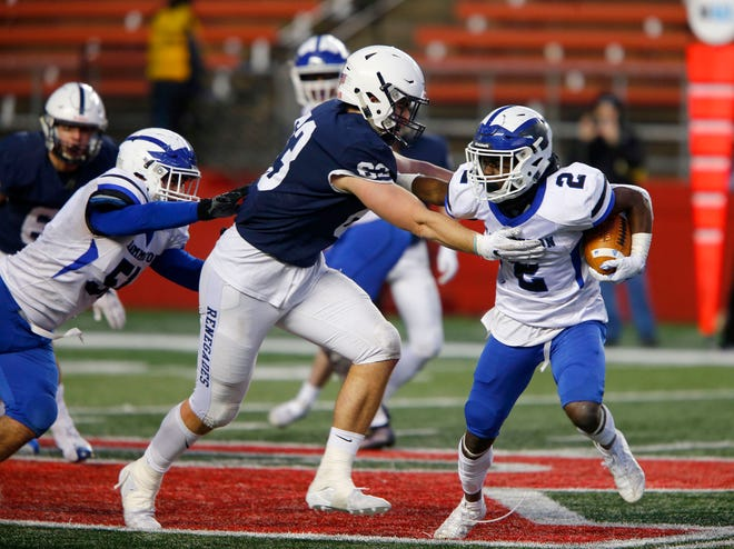 Mike Jarvis, left,  6-foot-5 and 250 pounds, played tackle in a four-man front and end in a three-man front last season for Shawnee High School in Medford, New Jersey.