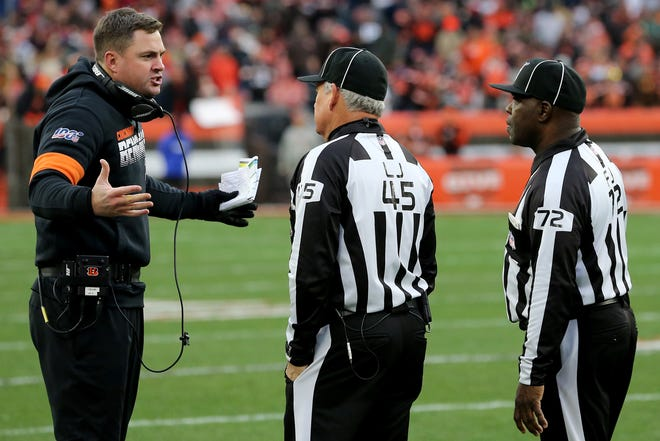 Cincinnati Bengals head coach Zac Taylor argues with officials in the fourth quarter during a Week 14 NFL football game against the Cleveland Browns, Sunday, Dec. 8, 2019, at FirstEnergy Stadium in Cleveland. The Cleveland Browns won 27-19, and the Cincinnati Bengals fell to 1-12 on the season.