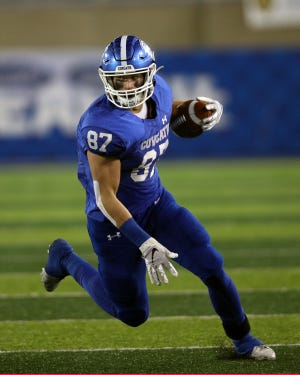 Cov Cath tight end Michael Mayer runs the ball after a catch in the KHSAA 5A state championship Dec. 7, 2019. Covington Catholic defeated Frederick Douglass 14-7.