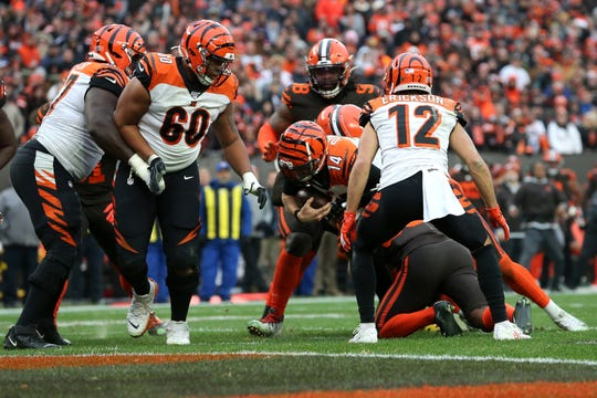 Cincinnati Bengals quarterback Andy Dalton (14) is unable to reach the end zone on a fourth-down play in the fourth quarter during a Week 14 NFL football game against the Cincinnati Bengals, Sunday, Dec. 8, 2019, at FirstEnergy Stadium in Cleveland. The Cleveland Browns won 27-19, and the Cincinnati Bengals fell to 1-12 on the season.