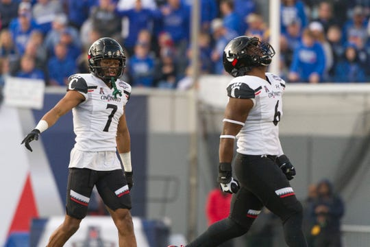 Cincinnati Bearcats linebacker Perry Young (6) and Cincinnati Bearcats cornerback Coby Bryant (7) react during the first half against the Memphis Tigers at Liberty Bowl Memorial Stadium.