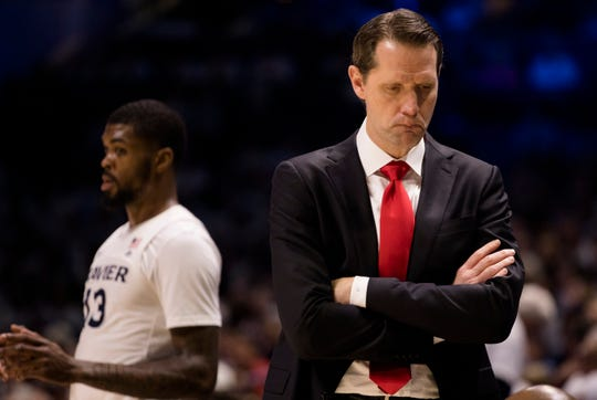 Cincinnati Bearcats head coach John Brannen reacts to a foul called on Cincinnati Bearcats in the second half of the NCAA basketball game between the Cincinnati Bearcats and the Xavier Musketeers on Saturday, Dec. 7, 2019, at the Cintas Center in Cincinnati. Xavier Musketeers defeated Cincinnati Bearcats 73-66.