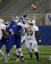Cov Cath quarterback Caleb Jacob attempts a pass in the KHSAA 5A state championship Dec. 7, 2019. Covington Catholic defeated Frederick Douglass 14-7.