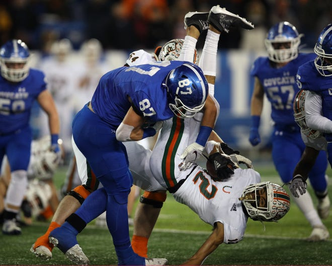 Cov Cath defensive end Michael Mayer slams Frederick Douglass wide receiver Dane Key down for negative yardage in the KHSAA 5A state championship Dec. 7, 2019. Covington Catholic defeated Frederick Douglass 14-7.