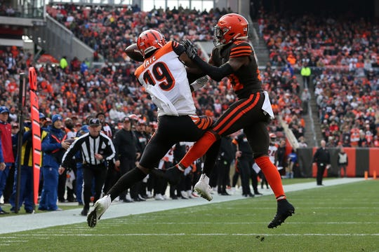 Cleveland Browns cornerback Denzel Ward (21) breaks up a pass intended for Cincinnati Bengals wide receiver Auden Tate (19) in the first quarter during a Week 14 NFL football game, Sunday, Dec. 8, 2019, at FirstEnergy Stadium in Cleveland.