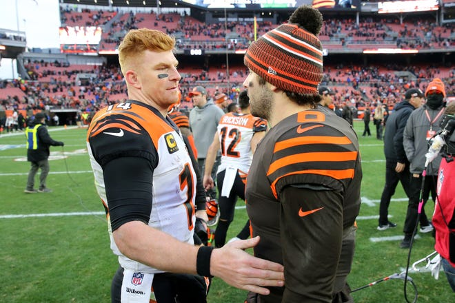 Cincinnati Bengals quarterback Andy Dalton (14) and Cleveland Browns quarterback Baker Mayfield (6) shake hands after a Week 14 NFL football game, Sunday, Dec. 8, 2019, at FirstEnergy Stadium in Cleveland. The Cleveland Browns won 27-19, and the Cincinnati Bengals fell to 1-12 on the season.