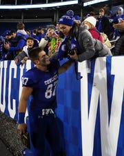 Covington Catholic's Michael Mayer meets his mother, Amy, in the stands after winning the KHSAA 5A state championship Dec. 7, 2019. Covington Catholic defeated Frederick Douglass 14-7.