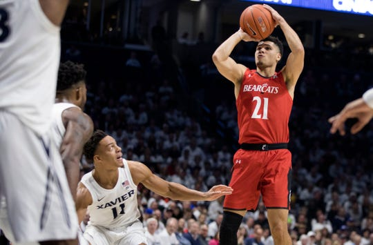 Cincinnati Bearcats guard Jaevin Cumberland (21) shoots over Xavier Musketeers guard Bryce Moore (11) in the second half of the NCAA basketball game between the Cincinnati Bearcats and the Xavier Musketeers on Saturday, Dec. 7, 2019, at the Cintas Center in Cincinnati. Xavier Musketeers defeated Cincinnati Bearcats 73-66.