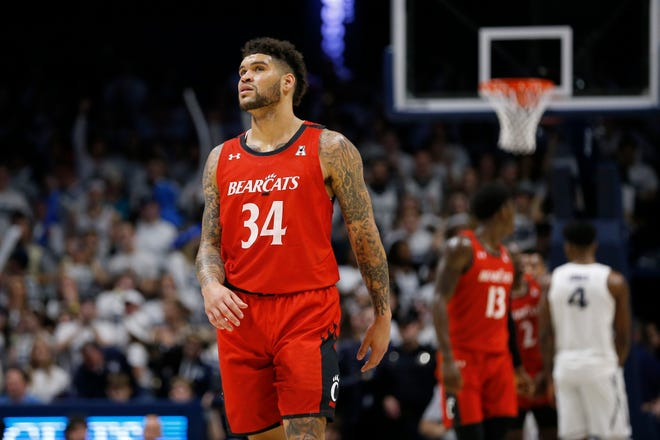 Cincinnati Bearcats guard Jarron Cumberland (34) looks to the scoreboard late in the second half of the Annual Crosstown Shootout rivalry game between the Xavier Musketeers and the Cincinnati Bearcats at the Cintas Center in Cincinnati on Saturday, Dec. 7, 2019. Xavier took the annual rivalry game, 73-66.