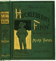 """Adventures of Huckleberry Finn"" by Mark Twain, American first edition."