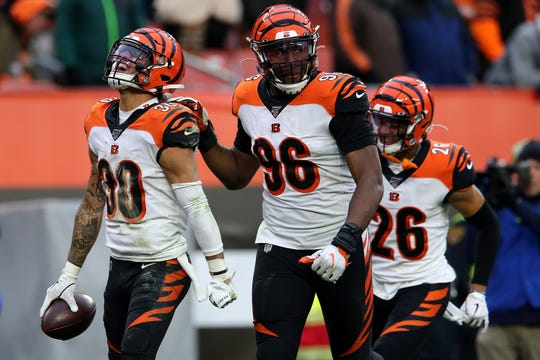Cincinnati Bengals free safety Jessie Bates (30), left, celebrates a would-be interception but after review, a pass interference penalty negated the play in the fourth quarter during a Week 14 NFL football game, Sunday, Dec. 8, 2019, at FirstEnergy Stadium in Cleveland. The Cleveland Browns won 27-19, and the Cincinnati Bengals fell to 1-12 on the season.