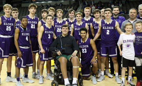 Ryan Custer joins the current Elder Panthers basketball team after their game against Huntington Prep, during the Griffin Elite Prep School Classic, Saturday, Dec. 7, 2019.